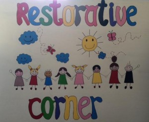 Drawing of children with restorative corner written - children are smiling